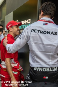 Sebastian Vettel (#5) and Toto Wolff talk in the paddock on Saturday of the 2019 Australian Grand Prix weekend. -------------------------------------------------- Photo taken by me - GDPHOTOS.COM.AU Saturday 16 March 19 Canon EOS 6D Mark II EF24-105mm f/4L IS USM @ 47mm 1/320 sec @ f5.6 1000 ISO Please credit if sharing -------------------------------------------------