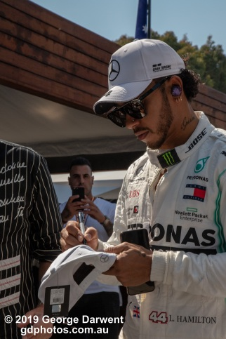 Lewis Hamilton (#44) of the Mercedes Formula 1 team signs an autograph for an elderly fanboy in the paddock on Sunday of the 2019 Australian Grand Prix weekend. -------------------------------------------------- Photo taken by me - GDPHOTOS.COM.AU Sunday 17 March 19 Canon EOS 6D Mark II EF24-105mm f/4L IS USM @ 82mm 1/500 sec @ f16 1000 ISO Please credit if sharing -------------------------------------------------