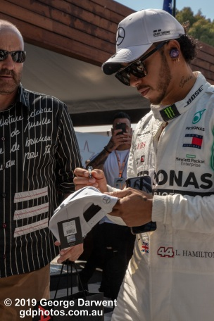 Lewis Hamilton (#44) of the Mercedes Formula 1 team signs an autograph for an elderly fanboy in the paddock on Sunday of the 2019 Australian Grand Prix weekend. -------------------------------------------------- Photo taken by me - GDPHOTOS.COM.AU Sunday 17 March 19 Canon EOS 6D Mark II EF24-105mm f/4L IS USM @ 73mm 1/500 sec @ f14 1000 ISO Please credit if sharing -------------------------------------------------