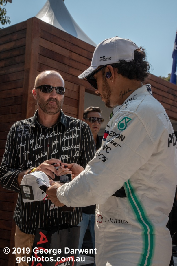 Lewis Hamilton (#44) of the Mercedes Formula 1 team signs an autograph for an elderly fanboy in the paddock on Sunday of the 2019 Australian Grand Prix weekend. -------------------------------------------------- Photo taken by me - GDPHOTOS.COM.AU Sunday 17 March 19 Canon EOS 6D Mark II EF24-105mm f/4L IS USM @ 50mm 1/500 sec @ f14 1000 ISO Please credit if sharing -------------------------------------------------
