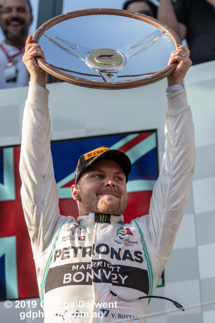 Valtteri Bottas (#77) of the Mercedes Formula 1 team on the podium of the 2019 Australian Grand Prix weekend. -------------------------------------------------- Photo taken by me - GDPHOTOS.COM.AU Sunday 17 March 19 Canon EOS 6D Mark II EF100-400mm f/4.5-5.6L IS II USM +1.4x III @ 280mm 1/1250 sec @ f8 1000 ISO Please credit if sharing -------------------------------------------------