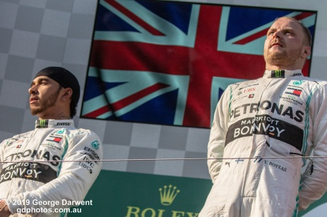 Valtteri Bottas (#77) and Lewis Hamilton of the Mercedes Formula 1 team on the podium of the 2019 Australian Grand Prix weekend. -------------------------------------------------- Photo taken by me - GDPHOTOS.COM.AU Sunday 17 March 19 Canon EOS 6D Mark II EF100-400mm f/4.5-5.6L IS II USM +1.4x III @ 140mm 1/2500 sec @ f8 1000 ISO Please credit if sharing -------------------------------------------------