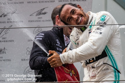 Lewis Hamilton (#44) of the Mercedes Formula 1 team celebrating on the podium of the 2019 Chinese Grand Prix. -------------------------------------------------- Photo taken by me - GDPHOTOS.COM.AU Sunday 14 April 19 Canon EOS 6D Mark II EF100-400mm f/4.5-5.6L IS II USM +1.4x III @ 490mm 1/1000 sec @ f8 1250 ISO Please credit if sharing -------------------------------------------------