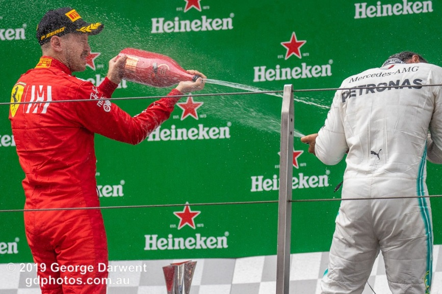 Sebastian Vettel (#5) of the Ferrari Formula 1 team celebrating on the podium of the 2019 Chinese Grand Prix with Lewis Hamilton. -------------------------------------------------- Photo taken by me - GDPHOTOS.COM.AU Sunday 14 April 19 Canon EOS 6D Mark II EF100-400mm f/4.5-5.6L IS II USM +1.4x III @ 309mm 1/1000 sec @ f7 1250 ISO Please credit if sharing -------------------------------------------------