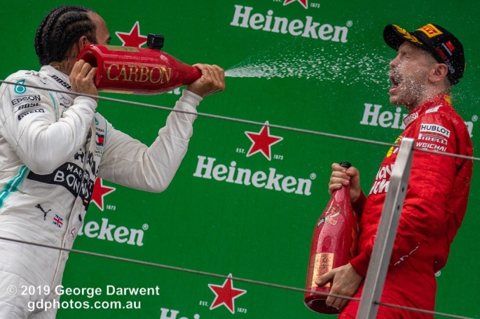 Lewis Hamilton (#44) of the Mercedes Formula 1 team celebrating on the podium of the 2019 Chinese Grand Prix with Sebastian Vettel. -------------------------------------------------- Photo taken by me - GDPHOTOS.COM.AU Sunday 14 April 19 Canon EOS 6D Mark II EF100-400mm f/4.5-5.6L IS II USM +1.4x III @ 368mm 1/1000 sec @ f7 1250 ISO Please credit if sharing -------------------------------------------------
