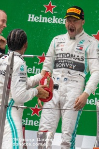 Valtteri Bottas (#77) of the Mercedes Formula 1 team celebrating on the podium of the 2019 Chinese Grand Prix with Lewis Hamilton. -------------------------------------------------- Photo taken by me - GDPHOTOS.COM.AU Sunday 14 April 19 Canon EOS 6D Mark II EF100-400mm f/4.5-5.6L IS II USM +1.4x III @ 318mm 1/1000 sec @ f8 1250 ISO Please credit if sharing -------------------------------------------------