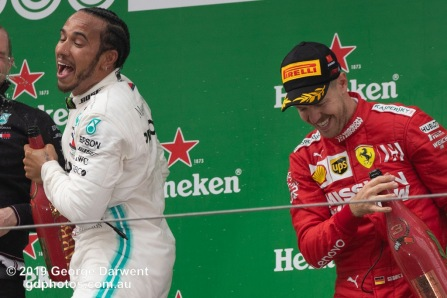 Lewis Hamilton (#44) of the Mercedes Formula 1 team celebrating on the podium of the 2019 Chinese Grand Prix with Sebastian Vettel. -------------------------------------------------- Photo taken by me - GDPHOTOS.COM.AU Sunday 14 April 19 Canon EOS 6D Mark II EF100-400mm f/4.5-5.6L IS II USM +1.4x III @ 318mm 1/1000 sec @ f7 1250 ISO Please credit if sharing -------------------------------------------------