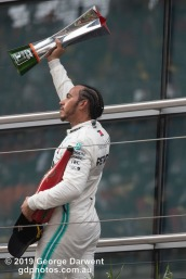 Lewis Hamilton (#44) of the Mercedes Formula 1 team celebrating on the podium of the 2019 Chinese Grand Prix. -------------------------------------------------- Photo taken by me - GDPHOTOS.COM.AU Sunday 14 April 19 Canon EOS 6D Mark II EF100-400mm f/4.5-5.6L IS II USM +1.4x III @ 476mm 1/1000 sec @ f8 1250 ISO Please credit if sharing -------------------------------------------------
