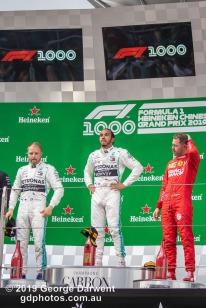 Lewis Hamilton (#44) of the Mercedes Formula 1 team celebrating on the podium of the 2019 Chinese Grand Prix alongside Valteri Bottas and Sebastian Vettel. -------------------------------------------------- Photo taken by me - GDPHOTOS.COM.AU Sunday 14 April 19 Canon EOS 6D Mark II EF100-400mm f/4.5-5.6L IS II USM +1.4x III @ 164mm 1/640 sec @ f7 800 ISO Please credit if sharing -------------------------------------------------
