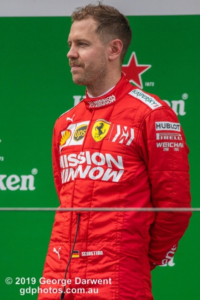 Sebastian Vettel (#5) of the Ferrari Formula 1 team celebrating on the podium of the 2019 Chinese Grand Prix. -------------------------------------------------- Photo taken by me - GDPHOTOS.COM.AU Sunday 14 April 19 Canon EOS 6D Mark II EF100-400mm f/4.5-5.6L IS II USM +1.4x III @ 560mm 1/1000 sec @ f8 1250 ISO Please credit if sharing -------------------------------------------------