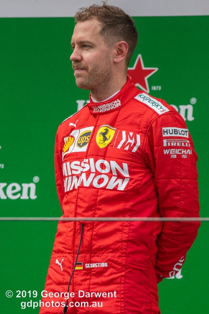 Sebastian Vettel (#5) of the Ferrari Formula 1 team celebrating on the podium of the 2019 Chinese Grand Prix. -------------------------------------------------- Photo taken by me - GDPHOTOS.COM.AU Sunday 14 April 19 Canon EOS 6D Mark II EF100-400mm f/4.5-5.6L IS II USM +1.4x III @ 560mm 1/1000 sec @ f8 1250 ISO Please credit if sharing -------------------------------------------------