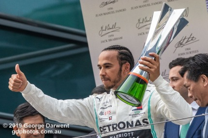 Lewis Hamilton (#44) of the Mercedes Formula 1 team celebrating on the podium of the 2019 Chinese Grand Prix. -------------------------------------------------- Photo taken by me - GDPHOTOS.COM.AU Sunday 14 April 19 Canon EOS 6D Mark II EF100-400mm f/4.5-5.6L IS II USM +1.4x III @ 318mm 1/1000 sec @ f7 1250 ISO Please credit if sharing -------------------------------------------------