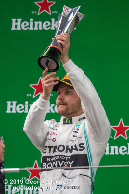 Valtteri Bottas (#77) of the Mercedes Formula 1 team celebrating on the podium of the 2019 Chinese Grand Prix. -------------------------------------------------- Photo taken by me - GDPHOTOS.COM.AU Sunday 14 April 19 Canon EOS 6D Mark II EF100-400mm f/4.5-5.6L IS II USM +1.4x III @ 560mm 1/1000 sec @ f8 1250 ISO Please credit if sharing -------------------------------------------------