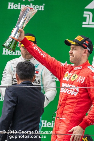 Sebastian Vettel (#5) of the Ferrari Formula 1 team celebrating on the podium of the 2019 Chinese Grand Prix. -------------------------------------------------- Photo taken by me - GDPHOTOS.COM.AU Sunday 14 April 19 Canon EOS 6D Mark II EF100-400mm f/4.5-5.6L IS II USM +1.4x III @ 358mm 1/1000 sec @ f7 1250 ISO Please credit if sharing -------------------------------------------------